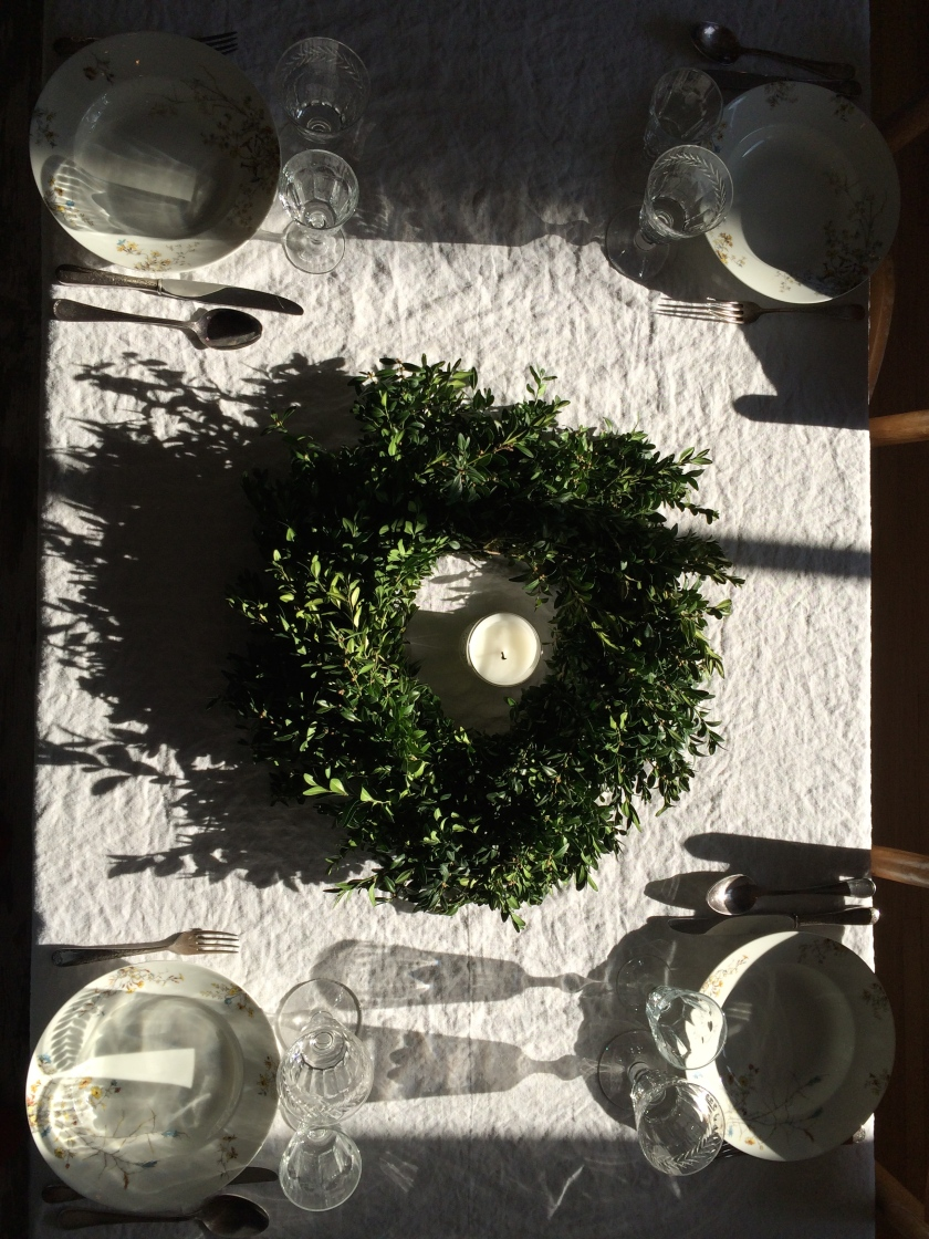 Holiday linen and greens table